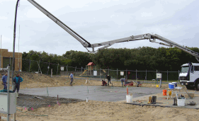 Pumping Concrete Into New Slab